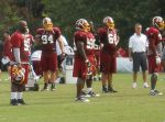 Albert Haynesworth (without helmet) watches practice as GM Bruce Allen looks on. All photos by Mike Frandsen